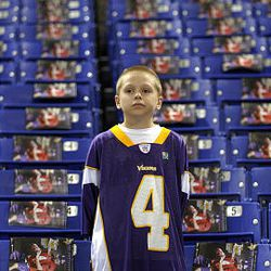 Jared Beck, 9,  of Fargo, N.D.  wears a Brett Favre jersey as he waits for the Vikings quarterback to get on the field prior to a  NFL preseason football game against the Kansas City Chiefs on Friday.