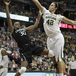 Baylor center Brittney Griner (42) trys to block Stanford forward Nnemkadi Ogwumike (30) shot during the second half in the NCAA women's Final Four semifinal college basketball game, in Denver, Sunday, April 1, 2012.