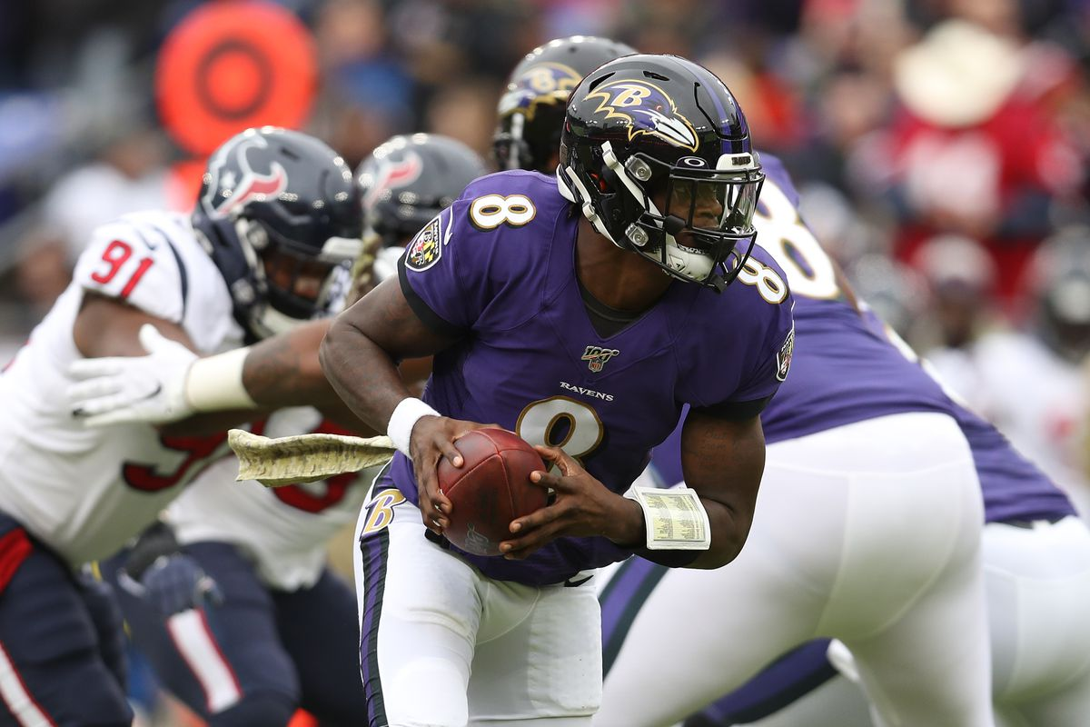 Quarterback Lamar Jackson of the Baltimore Ravens rolls out of the pocket against the Houston Texans during the second quarter at M&T Bank Stadium on November 17, 2019 in Baltimore, Maryland.