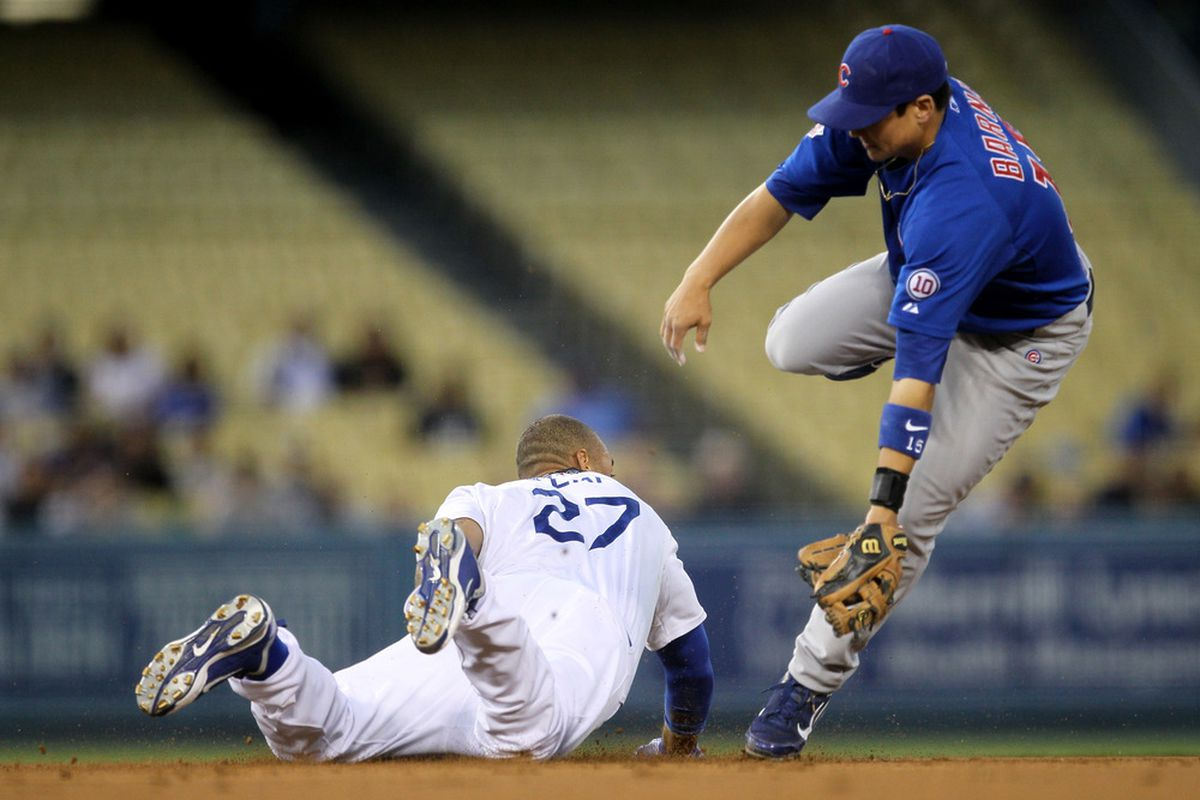 Matt Kemp of the Los Angeles Dodgers slides into second with a stolen base ahead of the throw to second baseman Darwin Barney of the Chicago Cubs  on May 2, 2011 at Dodger Stadium in Los Angeles, California.  (Photo by Stephen Dunn/Getty Images)