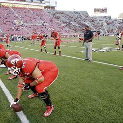 Utah Utes quarterbacks warm up prior to the BYU game in Salt Lake City  Saturday, Sept. 15, 2012.