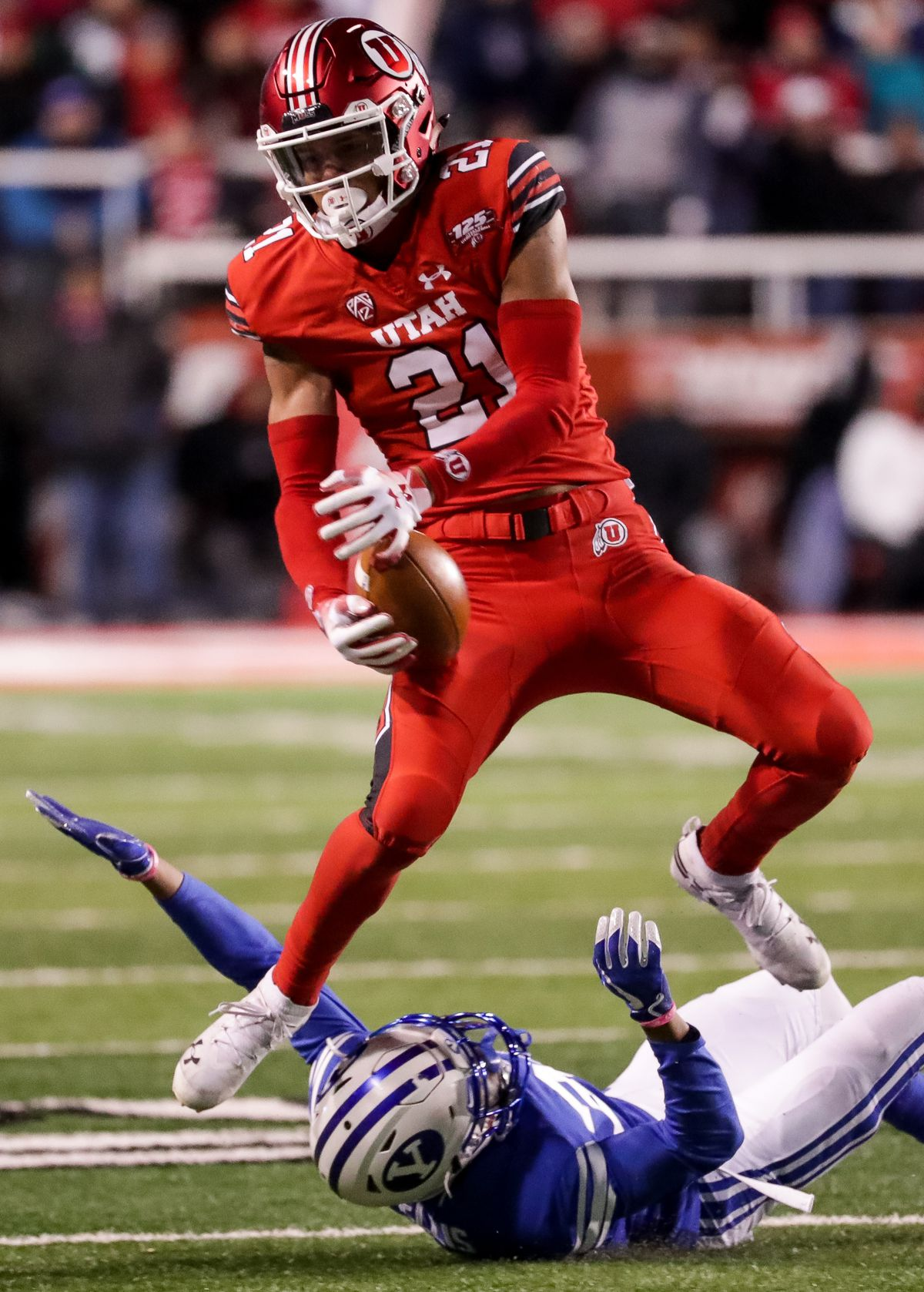 Utah Utes wide receiver Solomon Enis (21) makes a reception over Brigham Young Cougars defensive back Keenan Ellis (30) during the game at Rice-Eccles Stadium in Salt Lake City on Saturday, Nov. 24, 2018.