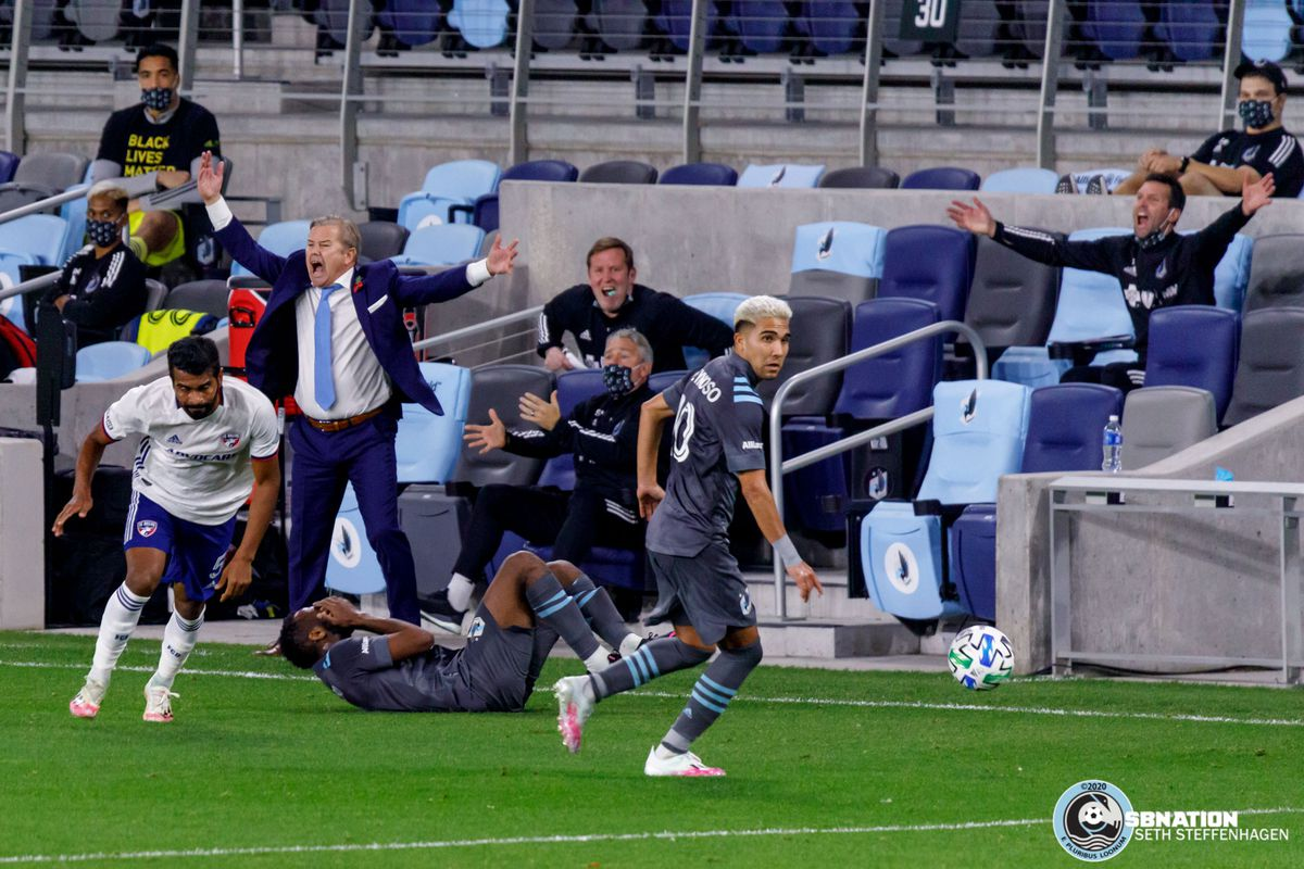 November 8, 2020 - Saint Paul, Minnesota, United States - Minnesota United head coach Adrian Heath and coaching staff look for a foul to be called on FC Dallas defender Thiago Santos (5) as Minnesota United midfielder Kevin Molino (7) hits the ground during the match at Allianz Field.