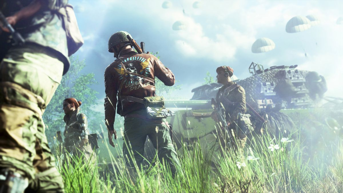 Players stand in a field in front of a British tank in Battlefield 5.