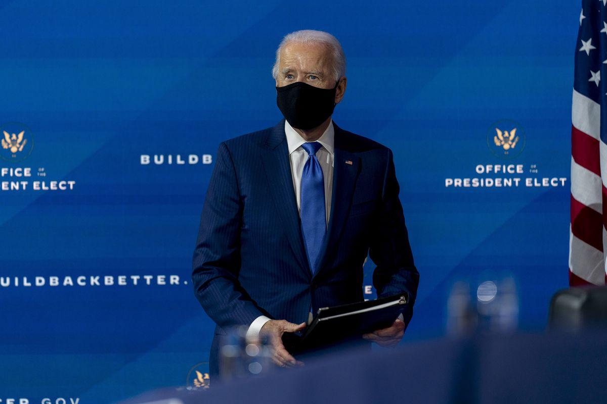 President-elect Joe Biden departs a news conference after introducing his nominees and appointees to economic policy posts at The Queen theater, Tuesday, Dec. 1, 2020, in Wilmington, Del.