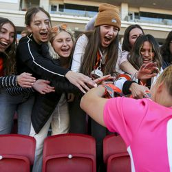 The Ogden student section celebrates with keeper Allison Collinwood after Ogden defeated Ridgeline in the 4A girls state championship 2-1 at Rio Tinto Stadium in Sandy on Friday, Oct. 25, 2019.