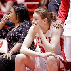 Utah's Diana Rolniak, center, is comforted by a teammate in the final minutes as Utah trails TCU in the University of Utah's 105-96 loss to Texas Christian University in quadruple overtime at the Huntsman Center in Salt Lake City on Wednesday.