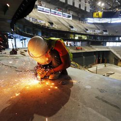 Julio Landin works with a grinder during the renovation of Vivint Smart Home Arena in Salt Lake City on Tuesday, June 27, 2017.