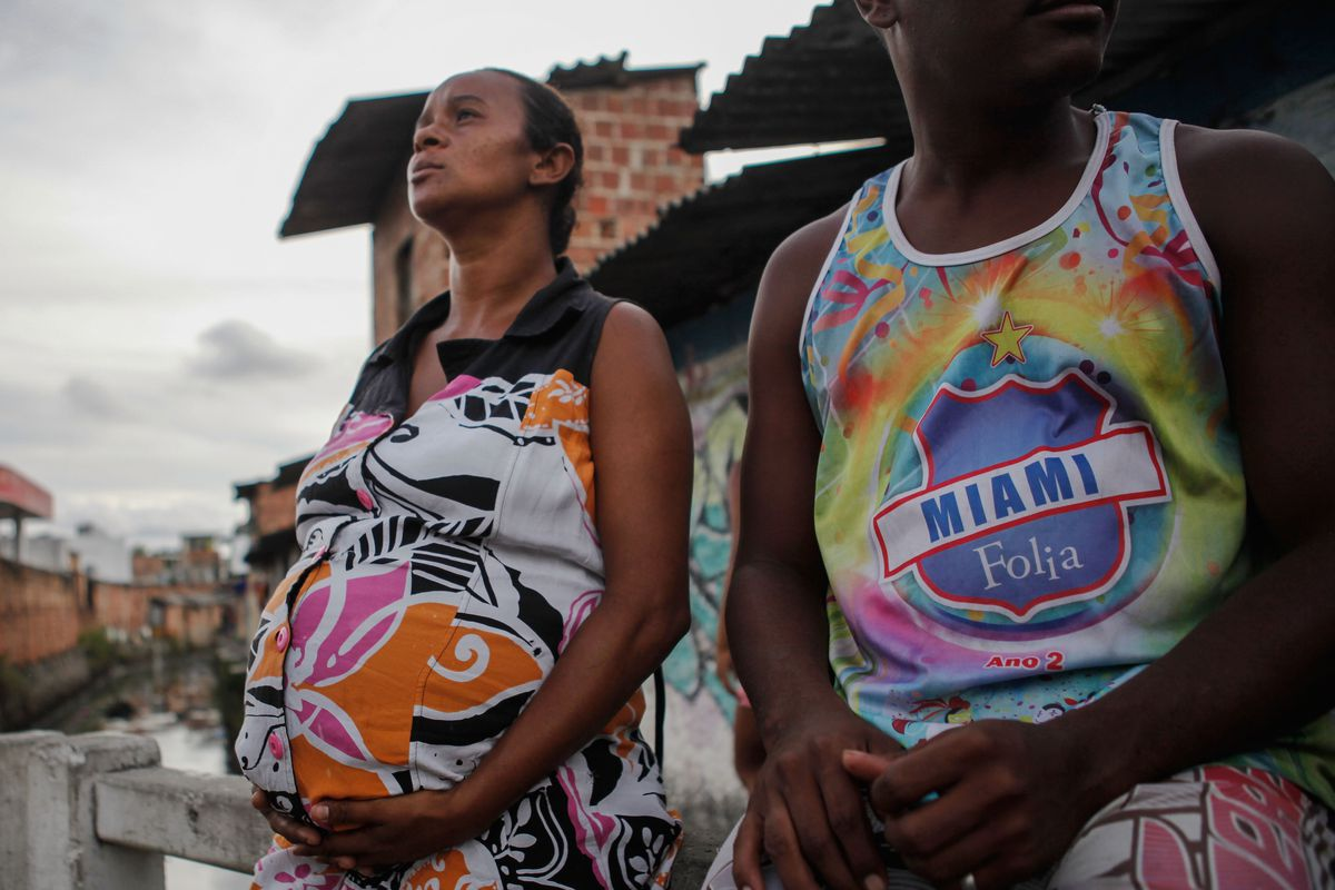 Joana Dark, eight months pregnant, sits with her husband in Recife, Pernambuco state, Brazil, one of the areas hardest hit by Zika, where the risks to pregnant women are real and immediate.