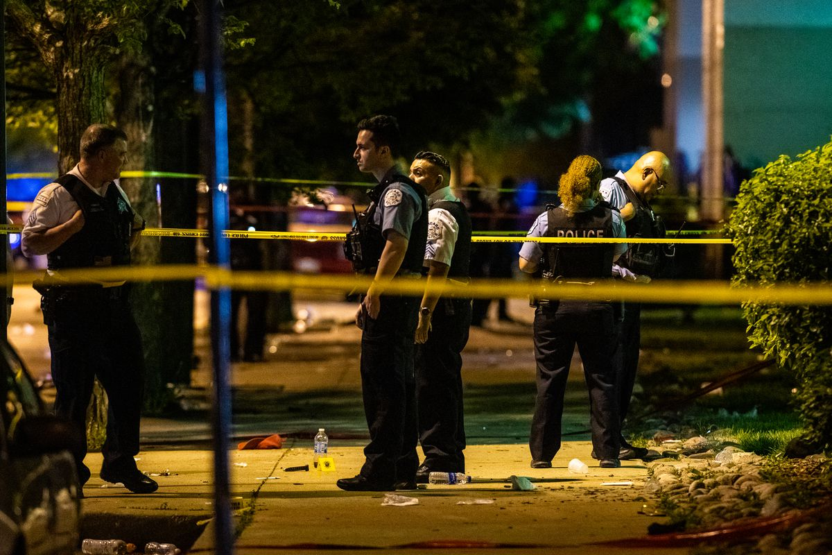Chicago Police investigate the scene where multiple people where shot in the 1400 block of West Hastings, Sunday morning on the Near West Side.