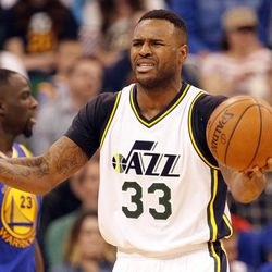Utah Jazz forward Trevor Booker (33) reacts after getting a foul called on him in the second half of an NBA regular season game against the Golden State Warriors at the Vivint Arena in Salt Lake City, Wednesday, March 30, 2016.