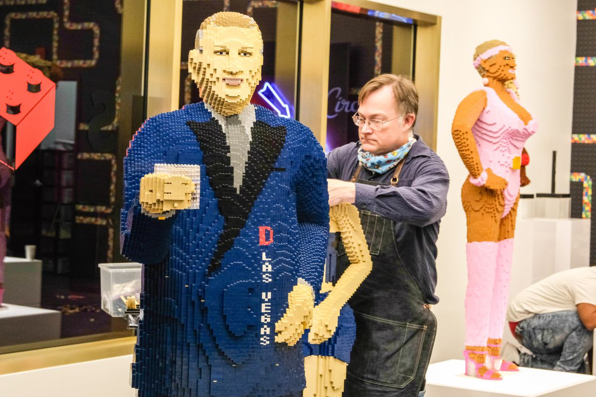 A sculpture of a man made from Legos.