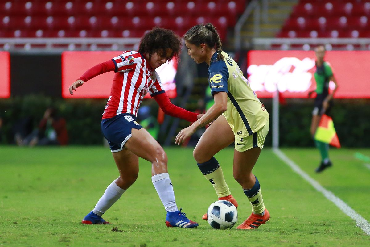 Casandra Montero (L) of Chivas fights for the ball with Angelica Palacios (R) of America during a match between Chivas and America as part of the Torneo Apertura 2021 Liga BBVA MX at Akron Stadium on October 11, 2021 in Zapopan, Mexico.