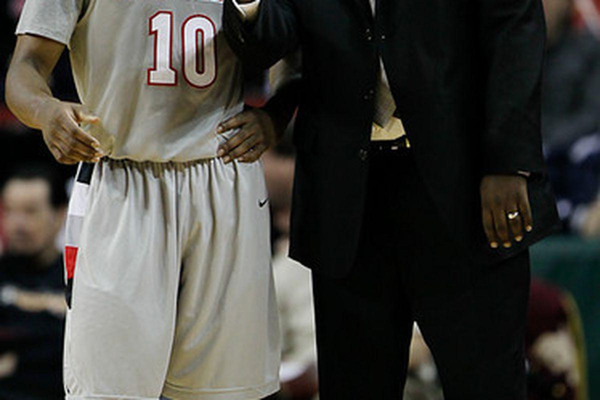 "Seattle University coach Cameron Dollar shares a light moment with freshman guard Sterling Carter. <em>Photo via <a href=""http://jlindstr.smugmug.com/photos/1109656310_pbevE-L.jpg"">jlindstr.smugmug.com</a>.</em>"