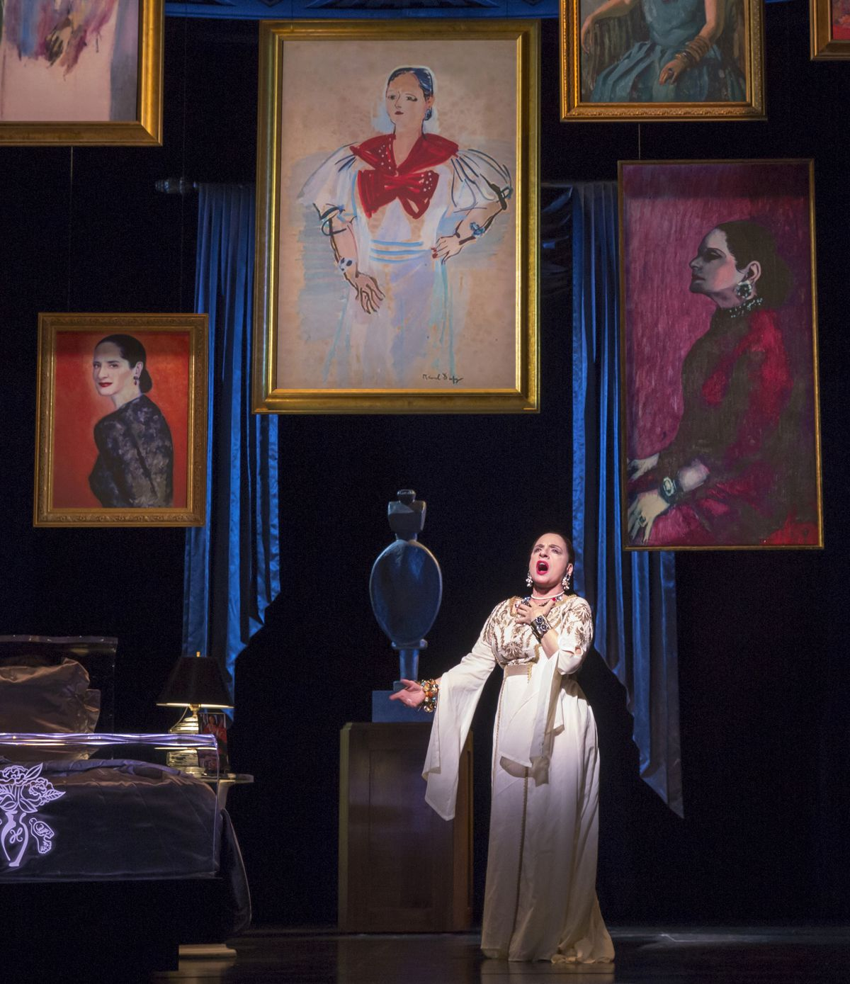 """Patti LuPone (as cosmetics mogul Helena Rubinstein) is surrounded by portraits in """"War Paint,"""" the world premiere musical at the Goodman Theatre. (Photo: Joan Marcus)"""