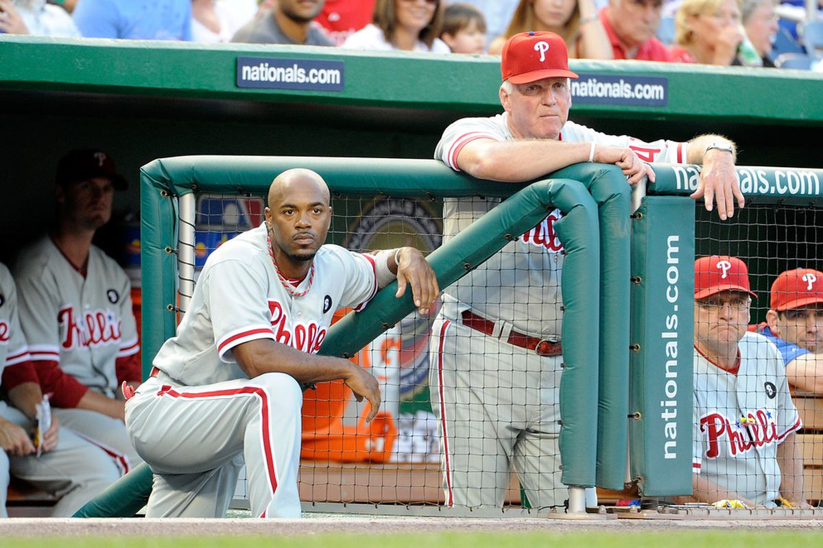 WASHINGTON, DC - AUGUST 20:  Manager Charlie Manuel #41 and Jimmy Rollins #11 of the Philadelphia Phillies watch the game against the Washington Nationals at Nationals Park on August 20, 2011 in Washington, DC.  (Photo by Greg Fiume/Getty Images)