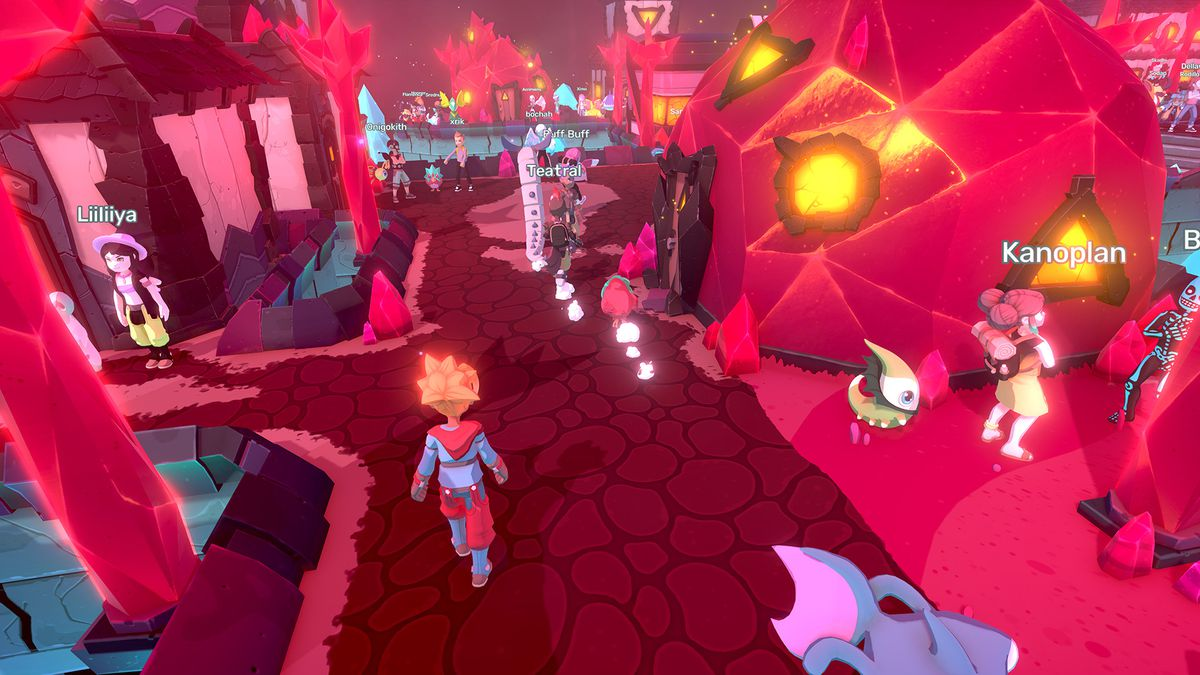 A bright-red Temtem town, populated by players.