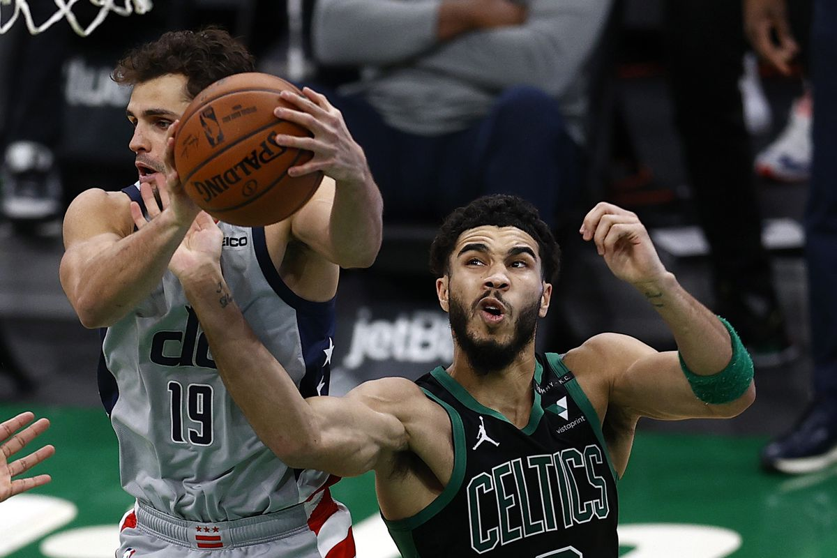Jayson Tatum of the Boston Celtics fouls Raul Neto  of the Washington Wizards during the third quarter at TD Garden on February 28, 2021 in Boston, Massachusetts.