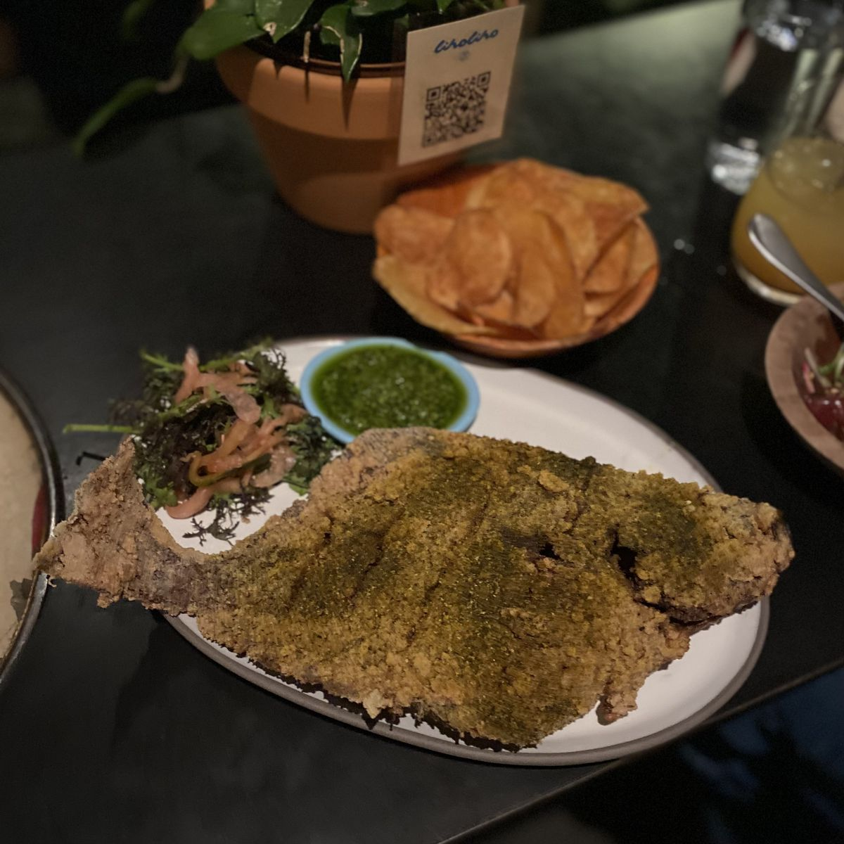 A whole fried fish with cilantro-ginger sauce at Liholiho Yacht Club