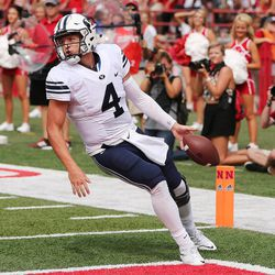 Brigham Young Cougars quarterback Taysom Hill (4) scores against Nebraska in Lincoln, NE Saturday, Sept. 5, 2015.