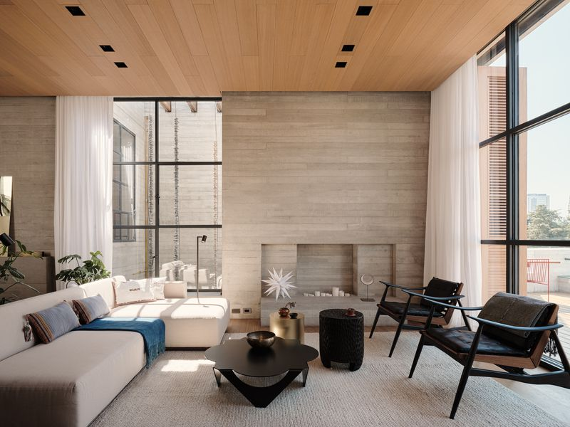 Bright living room with light gray walls and cream furniture.