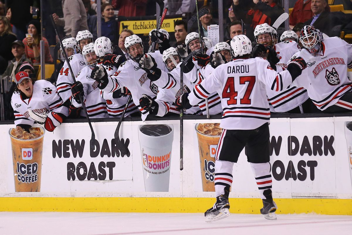 Northeastern players celebrate a goal in the 2015 Beanpot Tournament at the TD Garden in Boston, Mass.