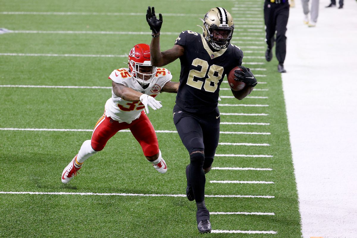Latavius Murray #28 of the New Orleans Saints scores a touchdown against Charvarius Ward #35 of the Kansas City Chiefs during the third quarter in the game at Mercedes-Benz Superdome on December 20, 2020 in New Orleans, Louisiana.