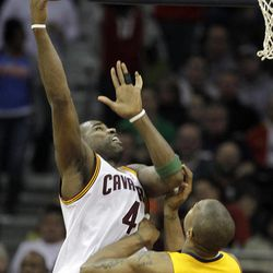 Cleveland Cavaliers' Antawn Jamison (4) hooks in a shot over Indiana Pacers' David West (21) in the second quarter of an NBA basketball game Wednesday, April 11, 2012, in Cleveland.