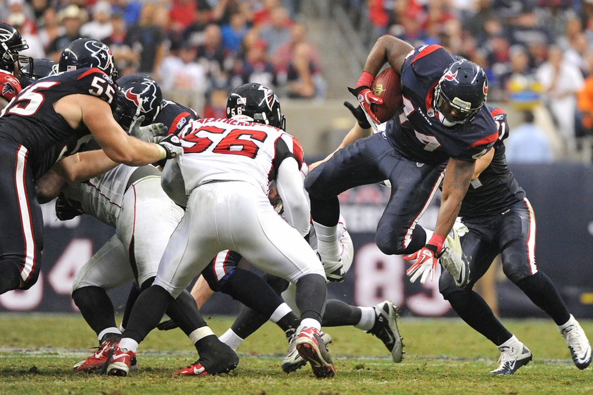 HOUSTON, TX - DECEMBER 04: Running back Ben Tate #44 of the Houston Texans is tripped up by the Atlanta Falcons defense on December 4, 2011 at Reliant Stadium in Houston, Texas. Texans won 17 to 10. (Photo by Thomas B. Shea/Getty Images)
