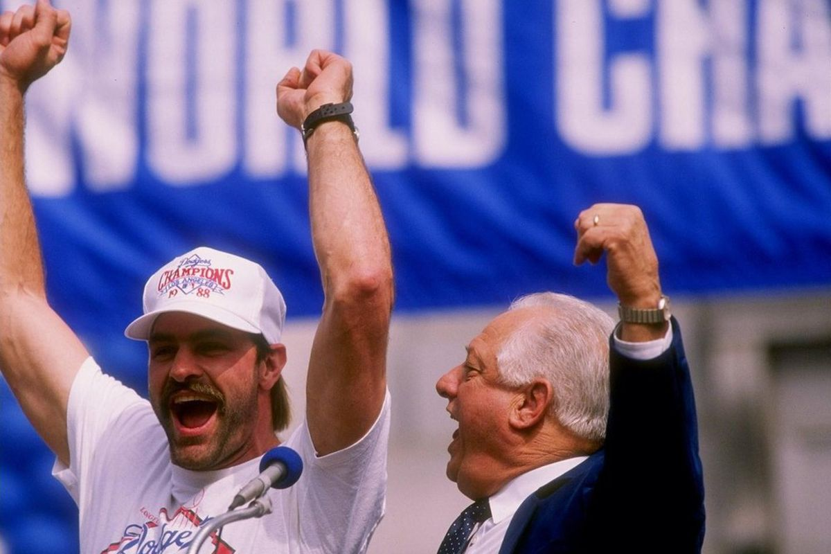 Kirk Gibson and Tommy Lasorda celebrate the Dodgers 1988 World Series win. <em>Photo Credit: Mike Powell / Getty Images</em>
