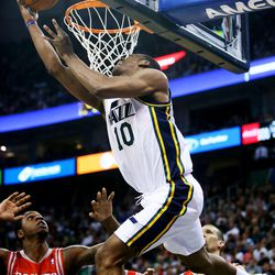 Utah Jazz's point guard Alec Burks (10) tries to flip the ball up and under the rim as the Jazz and the Rockets play Saturday, Nov. 2, 2013 in EnergySolutions arena. Jazz lose 104-93.