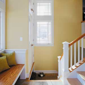 Home entryway with interior walls painted yellow.