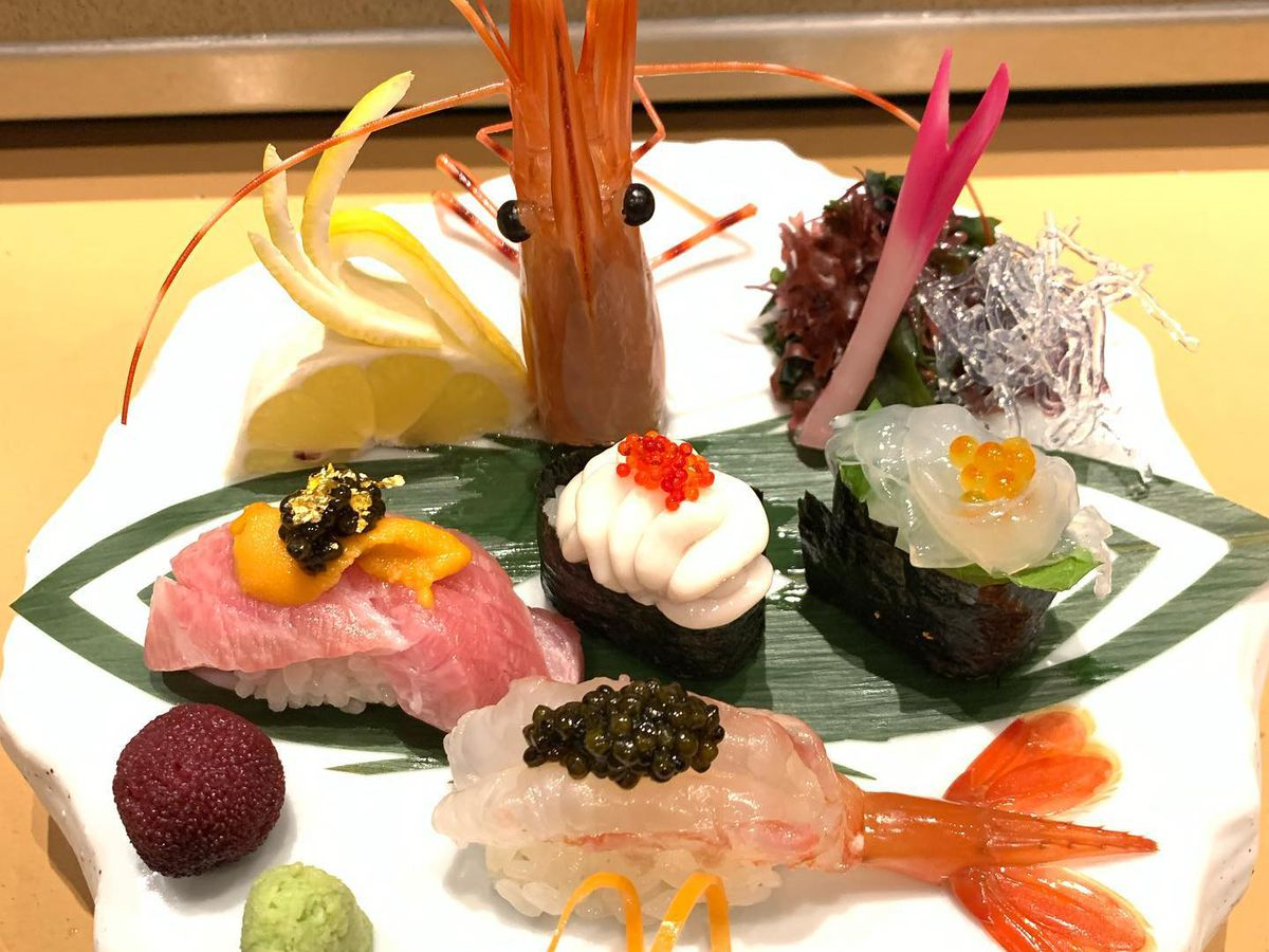 A variety of sushi dishes at a restaurant