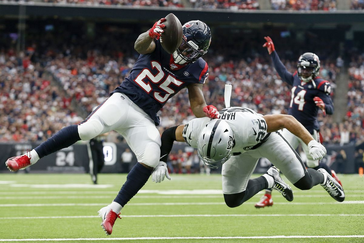Duke Johnson #25 of the Houston Texans scores a touchdown defended by Erik Harris #25 of the Oakland Raiders in the second quarter at NRG Stadium on October 27, 2019 in Houston, Texas.