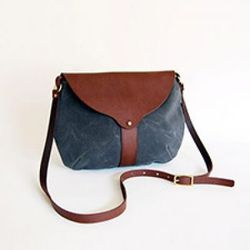 """Waxed canvas and leather purse by <a href=""""http://www.shelterprotectsyou.com"""">SHELTER</a>"""