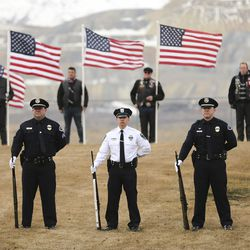 Officers and a patriot guard stand at attention during memorial services for Herriman police K-9 Hondo at Herriman High School in Herriman on Saturday, Feb. 29, 2020. The 7-year-old Belgian Malinois was shot and killed in the line of duty on Feb. 13 while trying to apprehend a wanted violent fugitive who was also shot and killed after officers say he displayed a gun.
