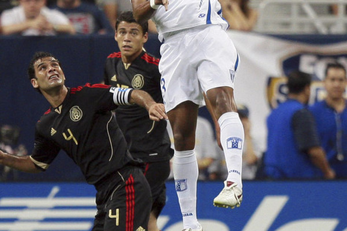 HOUSTON - JUNE 22:  Carlo Costly #13 of Honduras goes up for a header over Rafael Marquez #4 of Mexico in the second half at Reliant Stadium on June 22, 2011 in Houston, Texas.  (Photo by Bob Levey/Getty Images)