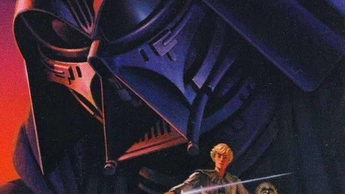 An old version of darth vader looms over luke skywalker on the 1975 cover of Star Wars