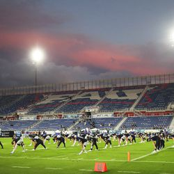 Brigham Young Cougars players warms up under the sunset prior to the Boca Raton Bowl in Boca Raton, FL on Tuesday, Dec. 22, 2020.