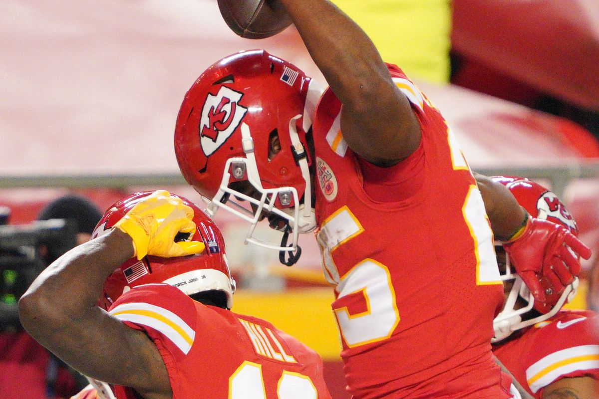 Kansas City Chiefs running back Clyde Edwards-Helaire celebrates with wide receiver Tyreek Hill after scoring a touchdown against the Buffalo Bills during the second quarter in the AFC Championship Game at Arrowhead Stadium.