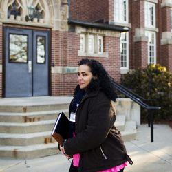 Raisa Carrasco-Velez, director of Multicultural Affairs & Community Development at St. John's Preparatory School, walks through the school's campus in Danvers, Massachusetts on March 13, 2017.