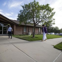 Community members walk into an LDS meetinghouse in Sandy  on Thursday, June 8, 2017, for an interfaith gathering after Tuesday's deadly shooting.