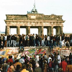This Nov. 10, 1989 file photo shows Germans from East and West standing on the Berlin Wall in front of the Brandenburg Gate, one day after the wall opened. Monday, Nov. 9, 2009 marks the 20th anniversary of the fall of the Berlin Wall.