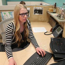 Leesa Allison works at her desk Tuesday, Nov. 26, 2013, in Salt Lake City.