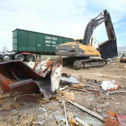 In this photo taken  Tuesday April 24, 2012, a crew begins removing parts of the Hush House at Gowen Field in Boise, Idaho. The Hush House was used for testing jet engines. Experts have found contaminated soil under the structure.