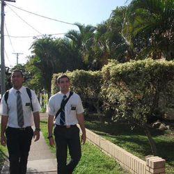Will Hopoate and a companion walk down the street in Brisbane, Australia. Will is now home from his mission and playing professional rugby.