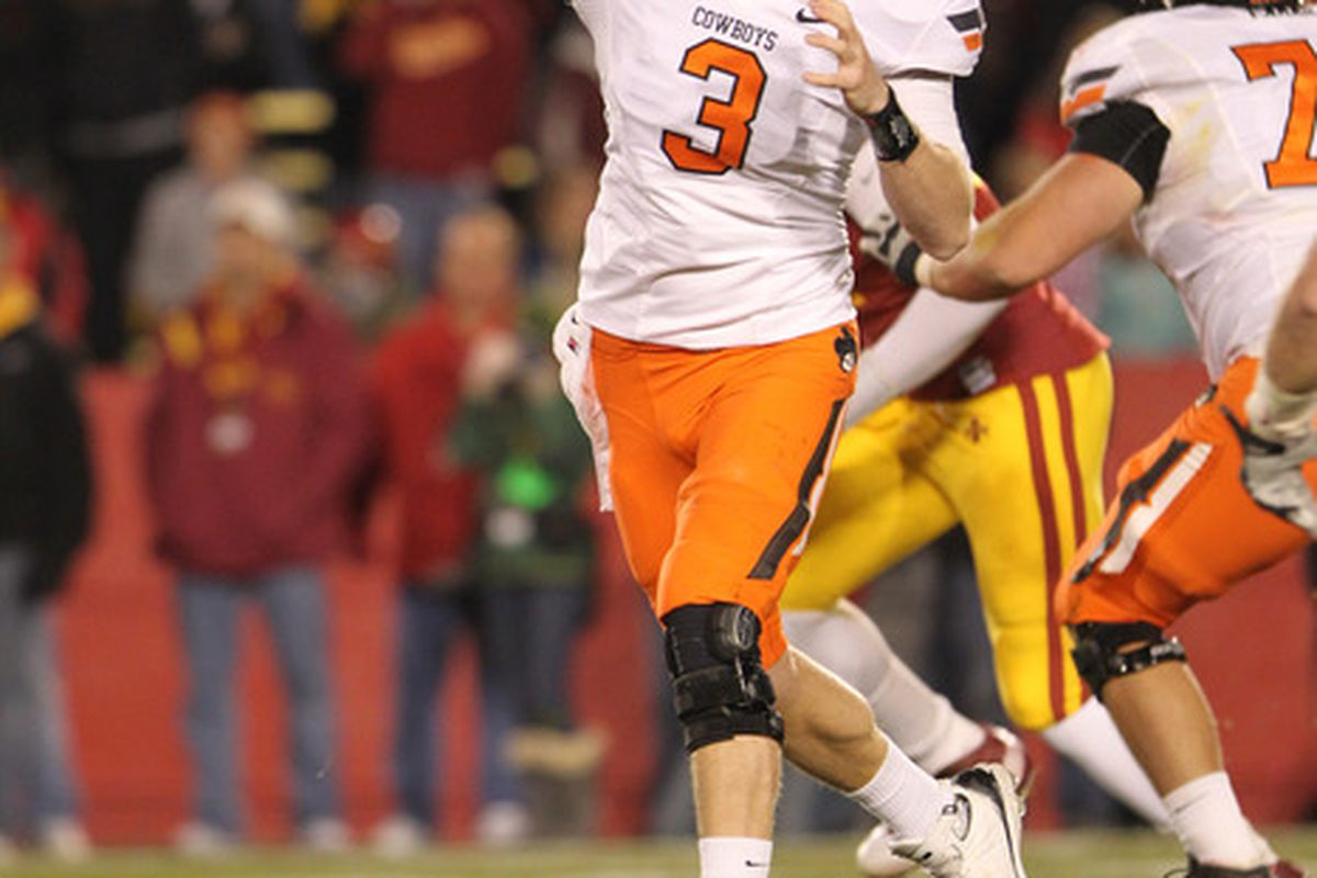 AMES, IA - NOVEMBER 18:  Brandon Weeden #3 of the Oklahoma State Cowboys throws a pass against the Iowa State Cyclones at Jack Trice Stadium November 18, 2011 in Ames, Iowa.  (Photo by Reese Strickland/Getty Images)