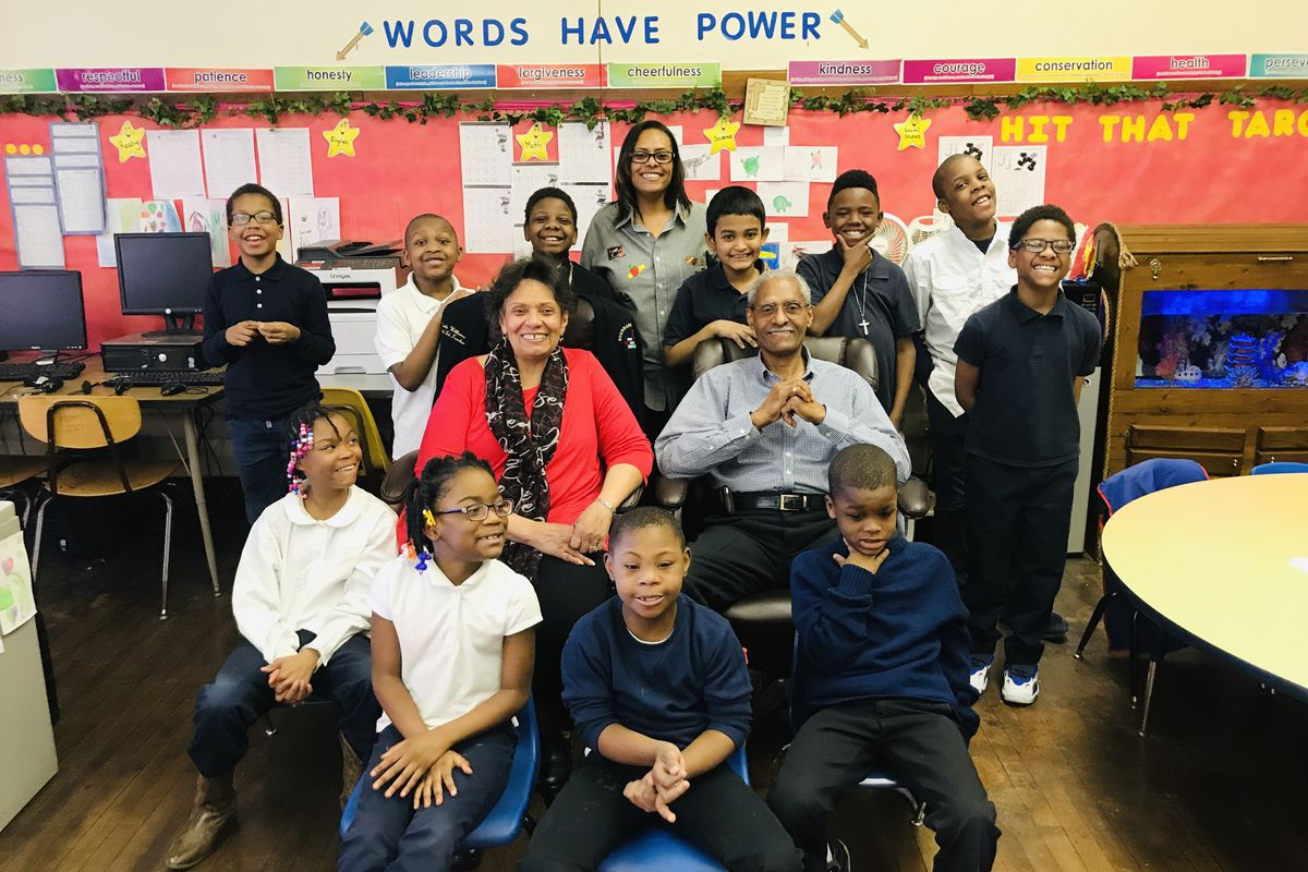 Marla Williams, a special education teacher at Davison Elementary-Middle School in Detroit (center, top row) is pictured with her parents and her students.