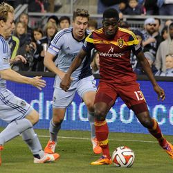 Real Salt Lake's Olmes Garcia looks for a place to maneuver as he is cornered by Sporting KC's Seth Sinovic, left, and Matt Besler during a game at Sporting Park in Kansas City, Kan., on Saturday, April 5, 2014.