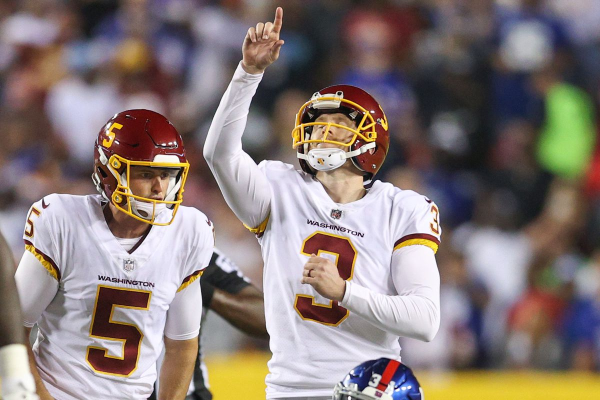 Dustin Hopkins #3 of the Washington Football Team reacts to kicking a field goal during the third quarter against the New York Giants at FedExField on September 16, 2021 in Landover, Maryland.
